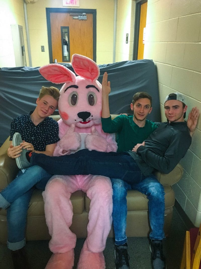Sophomore Silas Vinson, Senior Shane Livingston and Chad Zelner get their photo taken with the Easter Bunny at a second east Wengatz open house, Second Easter.