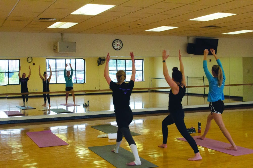 Yoga stretches students physically and spiritually