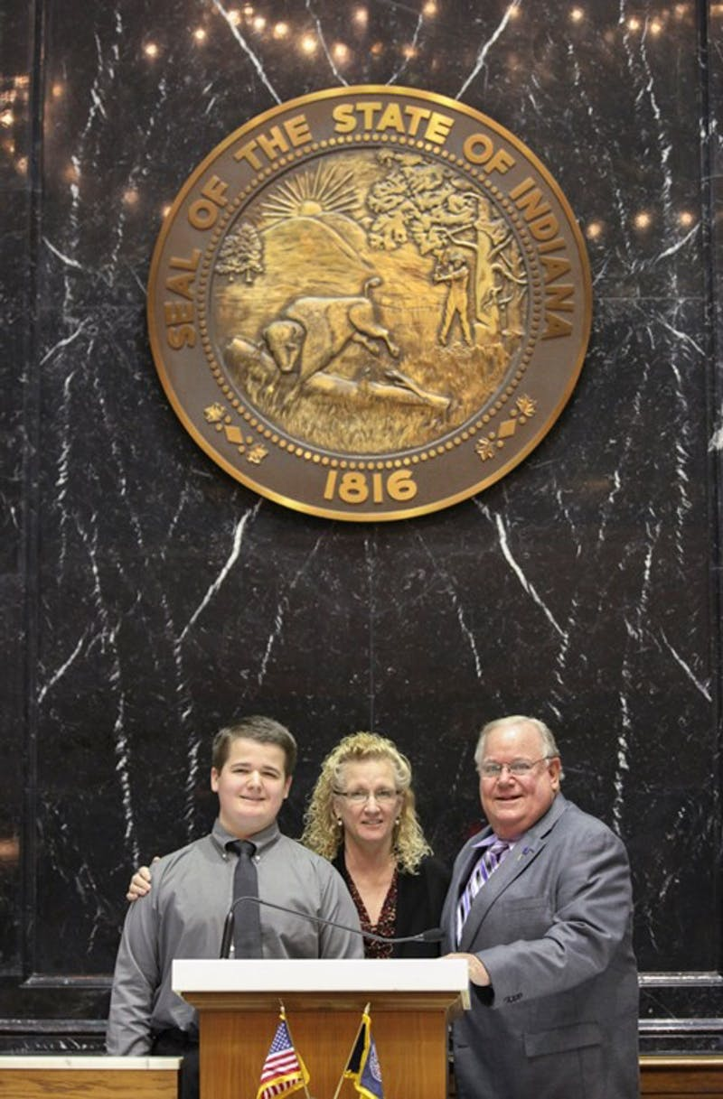 "From left to right: Joshua Clemens, Cheryl Clemens (""83) and Rep. Woddy Burton at Wednesday's Senate Education Committee hearing of HB-1108. (Photograph provided by Indiana House of Representatives)"