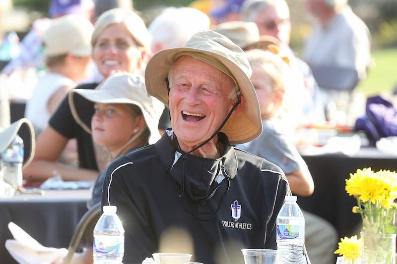 Former cross country and track Coach George Glass enjoys the cookout on Sept. 18.