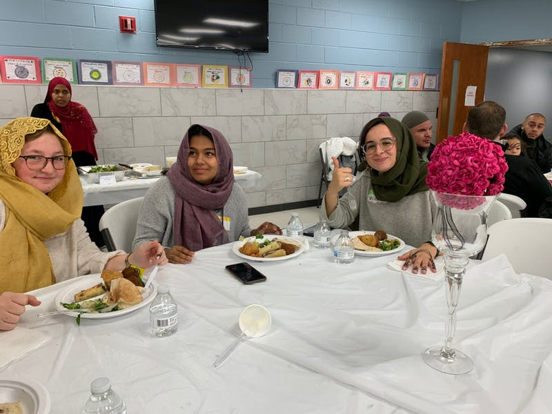Sophomores Hope Thomas and Grace Christodoss and junior Tori MacDonald shared a meal and conversation with Muslims at Wheaton College's Neighborly Faith Conference.