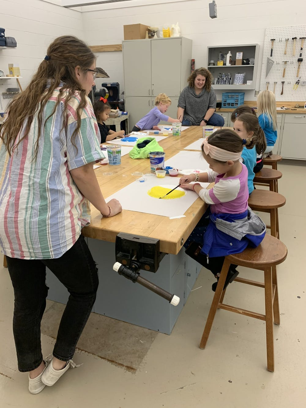 Elementary students learn art in college