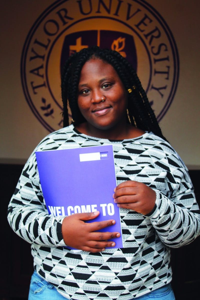 Senior Mykhail McClain models the traditional look of visiting students: clutching the purple admissions folder.
