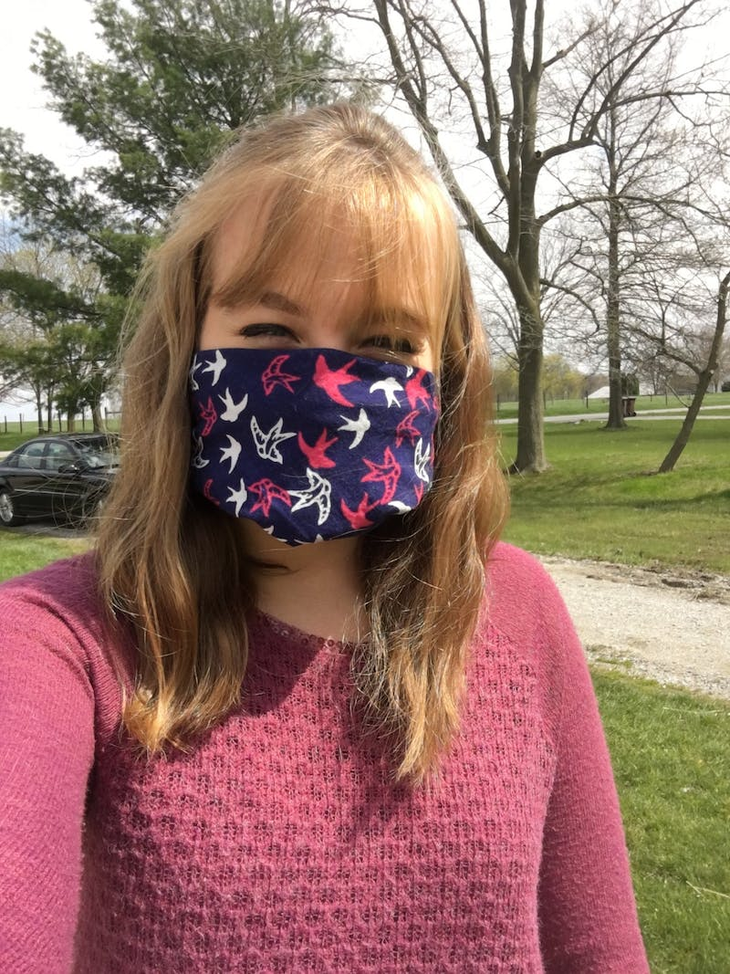 Abbey Russel sports her mask outside.