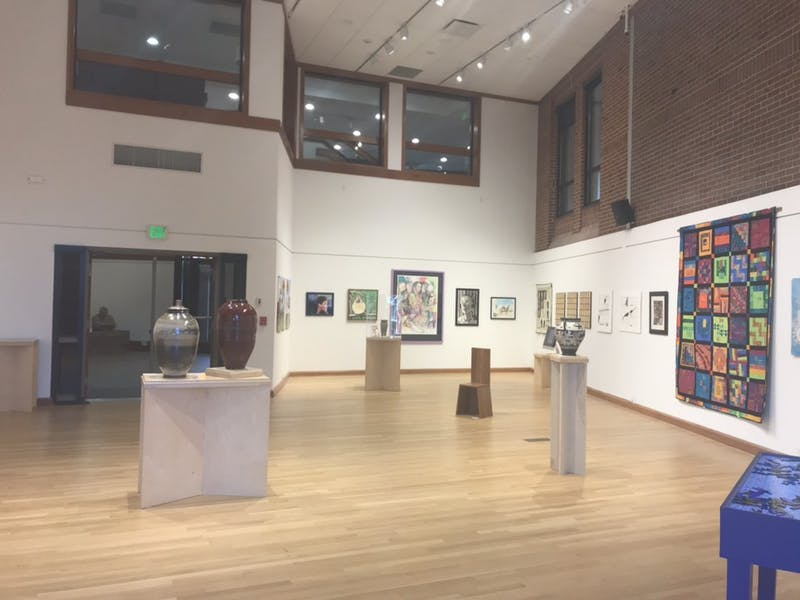 The Alumni Art & Design Exhibition will be displayed in Metcalf Gallery from now until Oct. 9. (Photo by Danielle Pitchard)