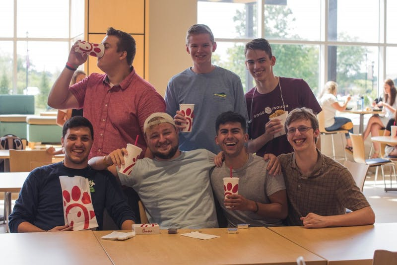 Men of Samuel Morris Hall enjoy Chick-Fil-A in the LaRita Boren Campus Center.