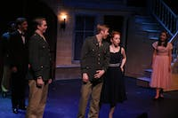 Benedict, played by senior John Broda, teases Beatrice, played by junior Madeline Logan.