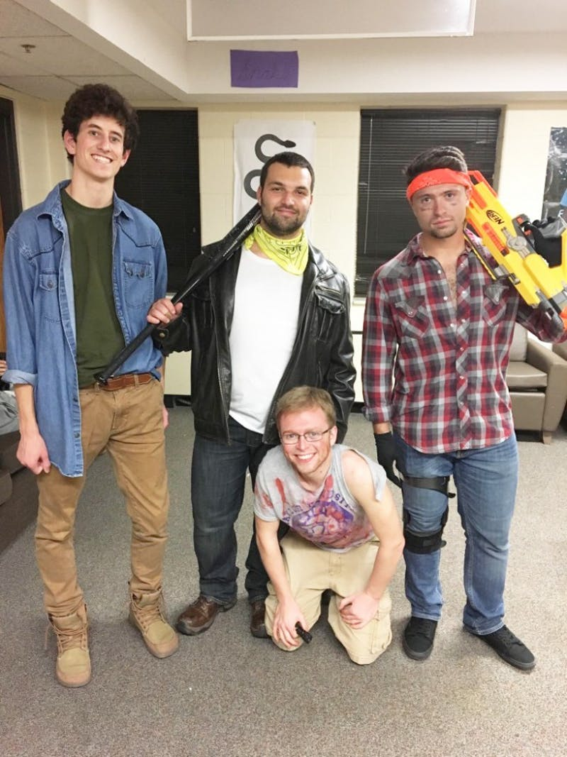 (L to R) Junior Noah Frances, senior Caleb Mackintosh, sophomore Alex Wood and junior Cameron Yeakle pose in the aftermath of the Brotherhood's zombie apocalypse last year. (Photograph provided by Adam Hursey)