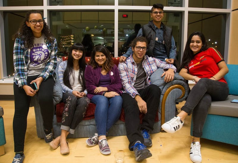 "Sophomore Amani Muya, freshman Maya Laytham, freshman Usha Kc, junior Samuel Thomas, junior Amish Mishra and freshman Mariana Pratas gather with other students from around the world at ""Welcome the MESA."" (Photograph by Abigail Roberts)"