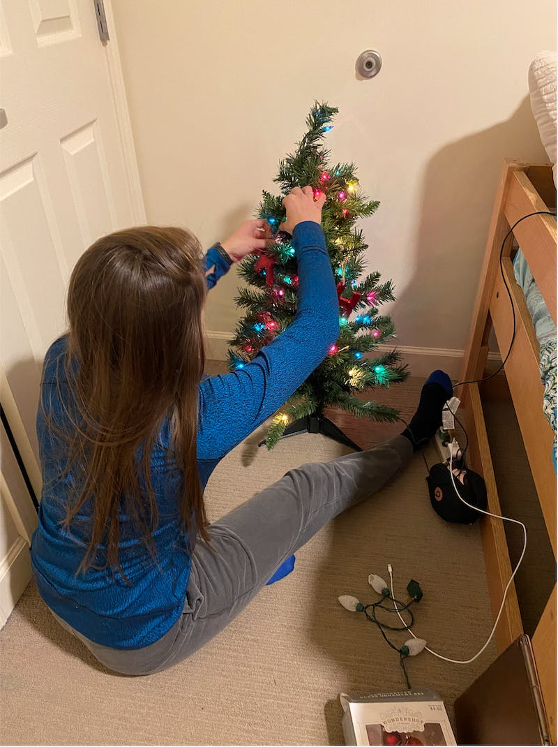 Senior Karolina Kahle decorating her tree for Christmas
