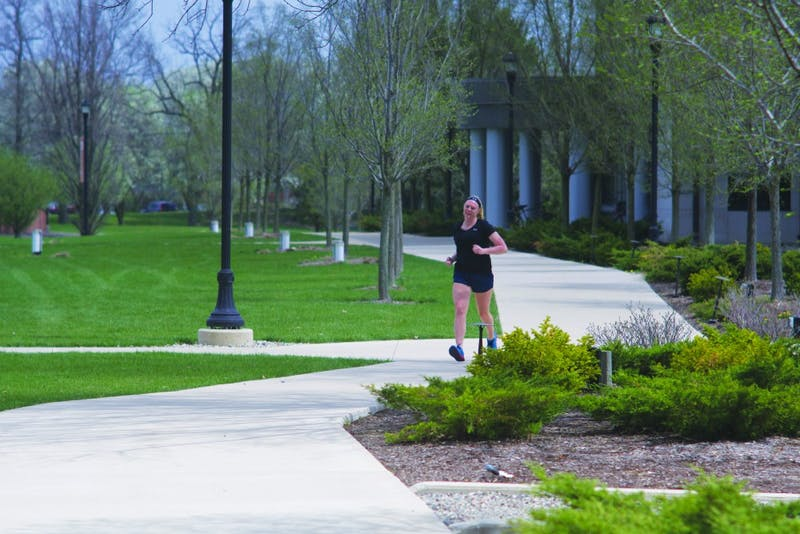 Senior Lilly Burton wrapped up her 20-week training regimen with a short run on Taylor's campus this past week. (Photograph by Tim Hudson)