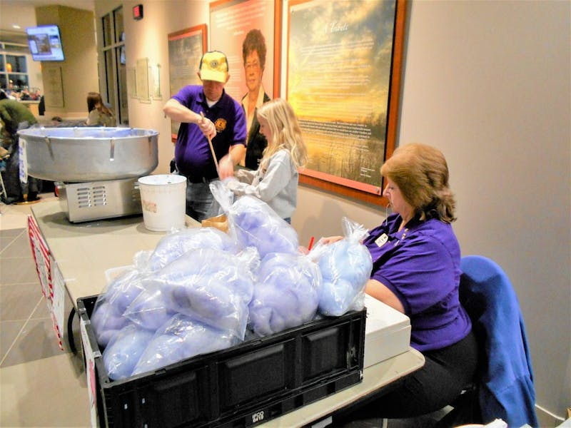 (L to R) Richard Wright, Susan Boyle, and Cindy Wright stuff bags of cotton candy at Airband 2017 for the Upland Lions Club
