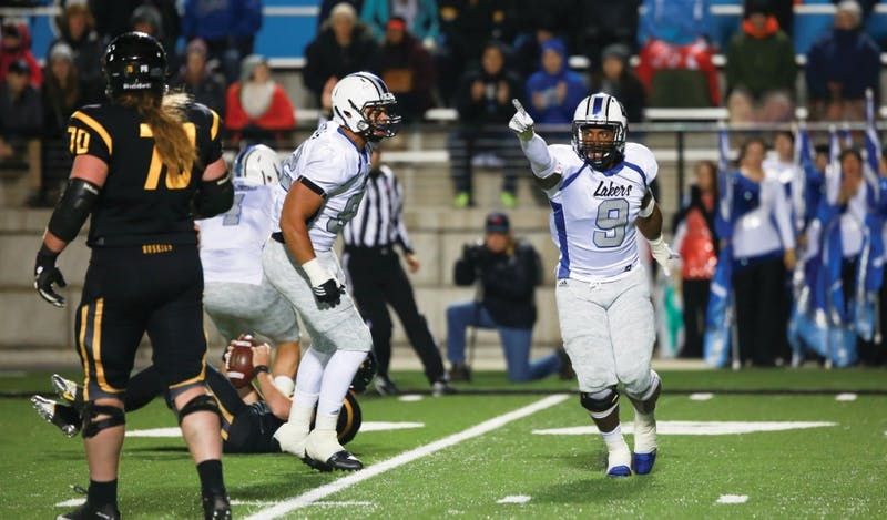 GVL / Kevin Sielaff - Matt Judon (9) hypes up his team after a sack. Grand Valley squares off against Michigan Tech Oct. 17 at Lubbers Stadium in Allendale. The Lakers defeated the Huskies with a score of 38-21.