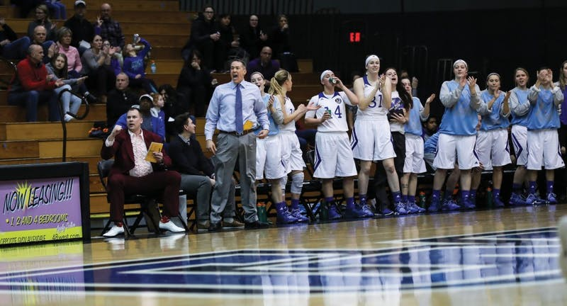 The Laker bench celebrates a three pointer during the game vs. Northwood inside the Fieldhouse Arena in Allendale on Thursday, Feb. 9, 2017.