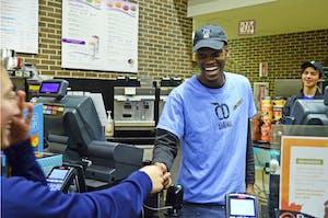 GVL / Emily Frye   Darryl Shongedza serves a customer at the campus dining Lobby Shop wearing his name tag on Sunday November 19, 2017.