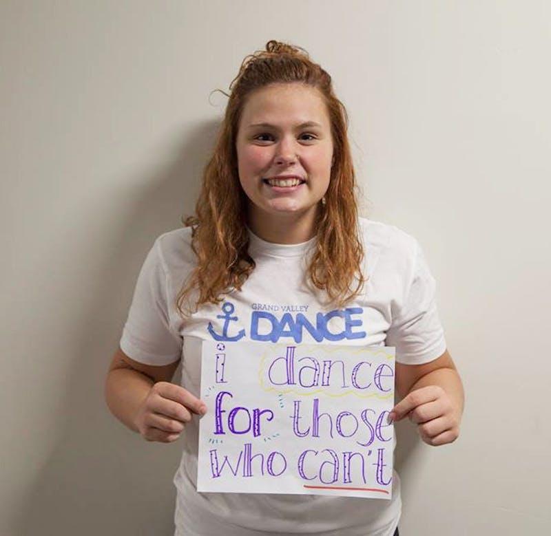 GVL / Courtesy - GVSU Dance MarathonHailey Garlich holds up a sign on Friday, Mar. 10, 2017 for the upcoming GVSU Dance Marathon that will take place on Saturday, Mar. 25, 2017.