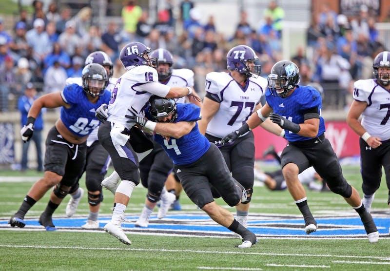 GVL / Emily FryeAlton Voss sacks the Truman State quarterback on Saturday Oct. 15, 2016.