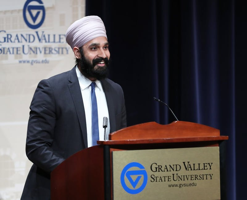 GVL/Kevin Sielaff - Dr. Simran Jeet Singh speaks to the crowd gathered at Loosemore Auditorium in downtown Grand Rapids on Thursday, March 30, 2017.
