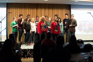 """GVL/Luke HolmesThe A Capella group """"GV Groove"""" hosted their Ugly Christmas Sweater Concert in the Grand River Room of Kirkhof Dec. 5."""