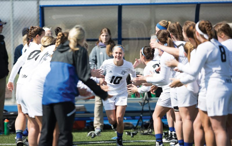 GVL / Kevin Sielaff – Chelsey Bishop (10) runs onto the field as the starting line-up is announced. The Lakers defeat the Greyhounds of the University of Indianapolis Saturday, March 26, 2016 with a final score of 15-4.