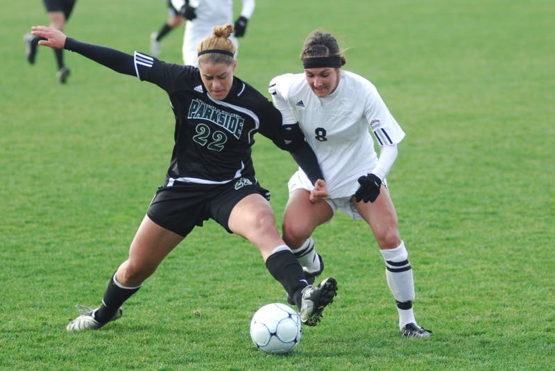 GVL Archvie /Andrew MillsJunior defender Megan Brown battles for the ball with a University of Wisconsin Parkside player during Friday