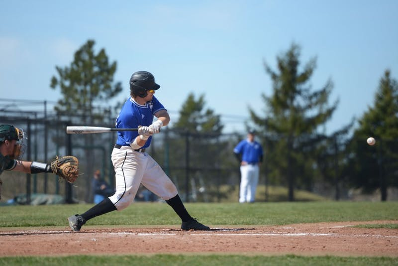 GVL / Luke Holmes - Austin LaDoux (24) swings at the ball. GVSU Men's Baseball played a double-header against Tiffin University on Saturday, April 1, 2016.