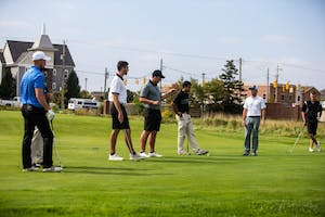 The team practices pitching the ball onto the green. The team participated in some drills on Tuesday, September 19th, 2017.