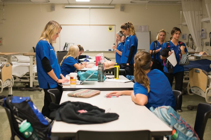GVL / Luke Holmes - Nursing Students finish up some work after class in the Center for Health Sciences building downtown.