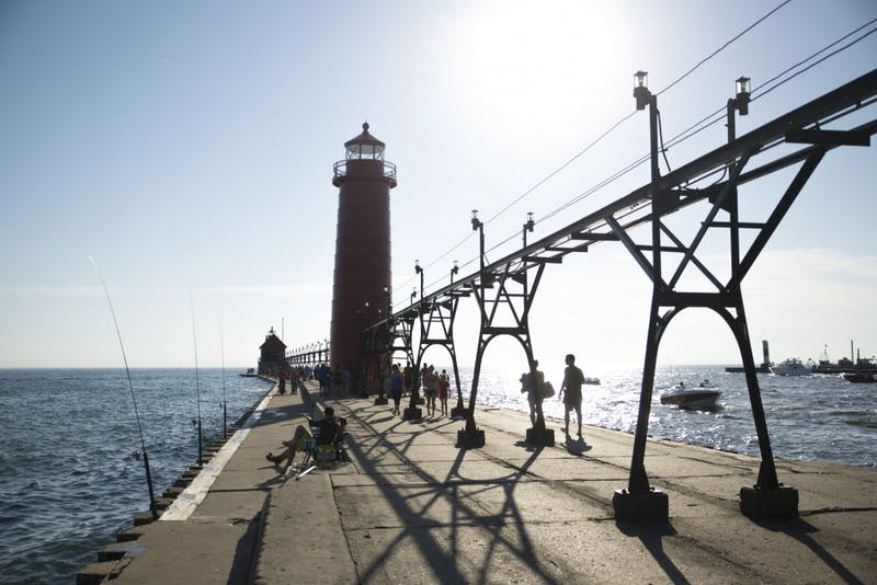 GVL / Luke Holmes - Grand Haven attracts many locals and visitors on a warm, sunny day.