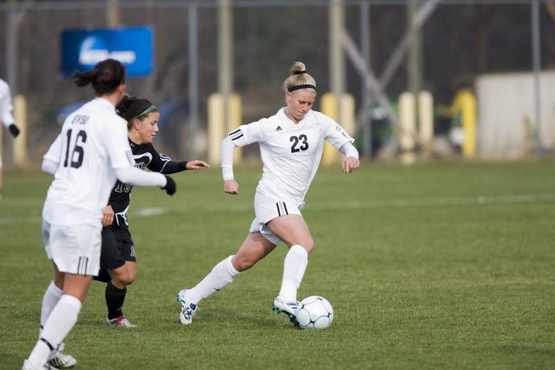 Courtesy/GVSU Athletics -Assistant coach Kristen Walker, formerly Kristen Eible, was a two-time national champion andfour-time All-GLIAC First Team midfielder for the Lakers from 2007-2010.
