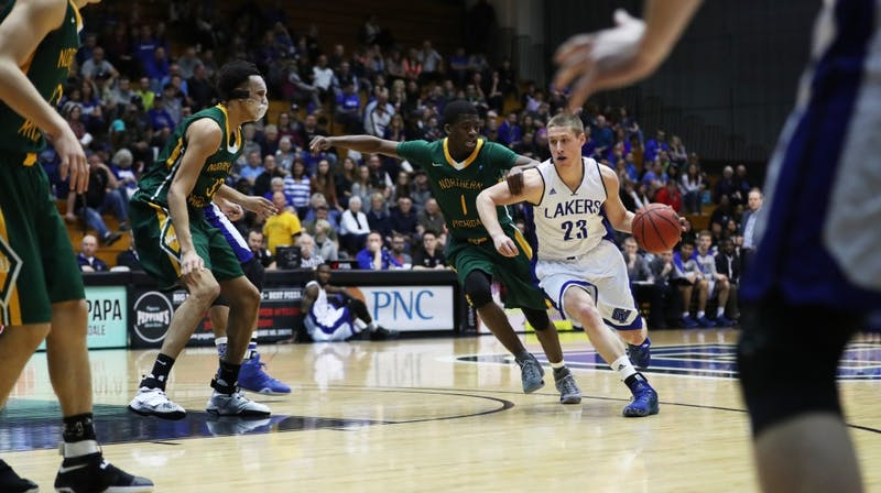 GVL/Kevin Sielaff - Luke Ryskamp (23) drives into the paint during the game against Northern Michigan on Saturday, Feb. 18, 2017 inside the Fieldhouse Arena in Allendale.