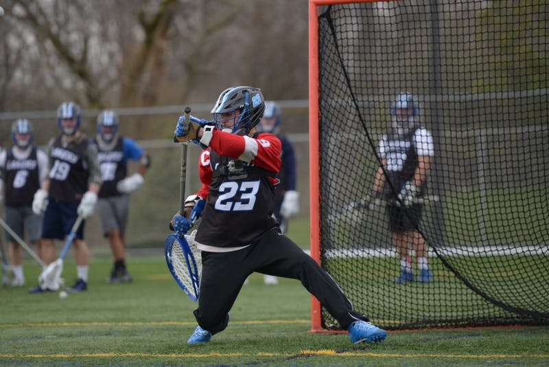 GVL / Luke Holmes - Sports Editor, Adam Knorr, takes on the challenge of being a lacrosse goalie at the turf field Tuesday, April 19, 2016.