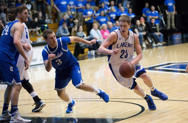 GVL / Kevin Sielaff - Luke Ryskamp (23) drives on net.  The Lakers defeat the Chargers of Hillsdale College Saturday, Jan. 30, 2016 in Allendale.