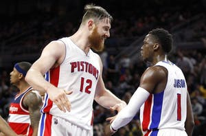 Friday, Apr 8, 2016; Auburn Hills, MI, USA; Detroit Pistons guard Reggie Jackson (1) celebrates with center Aron Baynes (12) during the fourth quarter against the Washington Wizards at The Palace of Auburn Hills. Pistons win 112-99. Mandatory Credit: Raj Mehta-USA TODAY Sports