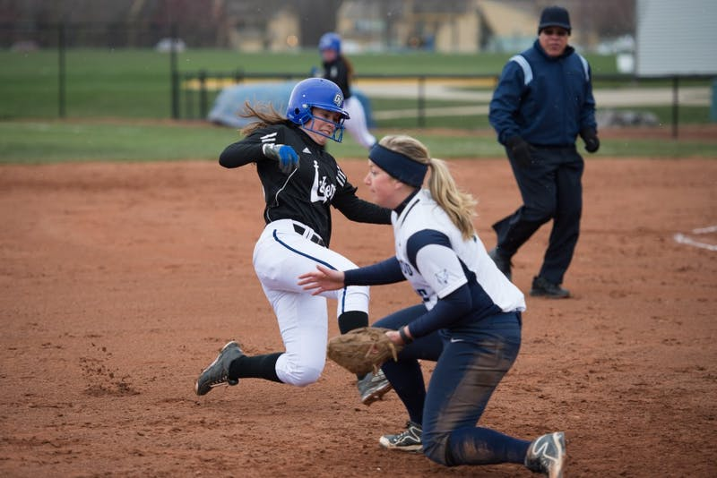 GVL / Luke Holmes - Kaylie Rhynard (6) slides into third base. Grand Valley State University defeated Northwood University in both games at the Grand Valley softball field Thursday, Apr. 7, 2016.