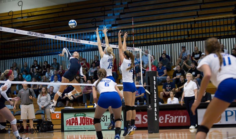 GVL / Kevin Sielaff     Kaleigh Lound (15) and Jillian Butsavich (12) attempt a block. The Laker Vollyeball team squares off against SVSU Sept. 19 inside the Fieldhouse Arena in Allendale. The Lakers defeated SVSU by a margin of 3-1.