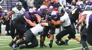 GVL / Kevin Sielaff -  Alton Voss (4) brings down an Ashland offensive attack.  Grand Valley defeats Ashland with a final score of 45-28 Nov. 22 at Ashland University.
