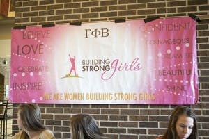 GVL / Sara Carte - Gamma Phi Beta sets up a booth for their Gamma Phive K run that is being held on April 17, in the Kirkhof center on Monday, Apr. 11, 2016.