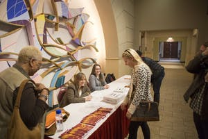 """GVL / Sara Carte - Grand Valley alumni and students come to watch the documentary screening of """"Girl Rising"""" in the DeVos Center on Friday, Mar. 25, 2016."""