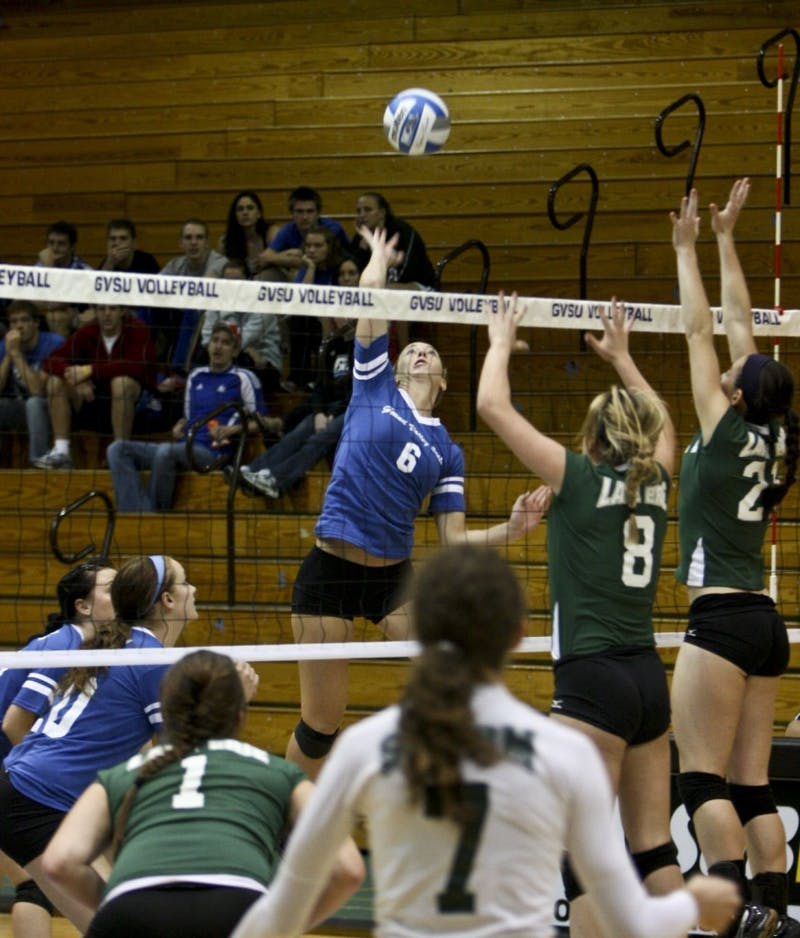 GVL Archive / Eric CoulterJunior Courtney McCotter jumps to send the ball ove the net