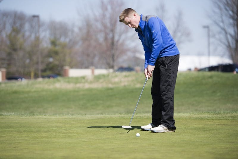 GVL / Luke Holmes - Alex Scott warms up on the practice green at The Meadows Golf Course Tuesday, Apr. 5, 2016.