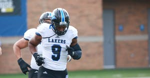GVL / Kevin Sielaff - Matt Judon (9) joins his teammates on the field at the start of the match. The Lakers fall to the Rams of Shepherd University with a final score of 34-32 Dec. 12 in Shepherdstown, West Virginia.