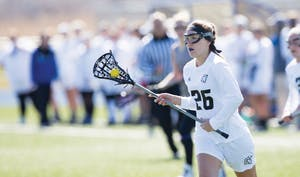 GVL / Kevin Sielaff – Katie Tomlinson (26) moves the ball up field. The Lakers defeat the Bearcats of McKendree University with a final score of 23-11 Friday, March 25, 2016 in Allendale.