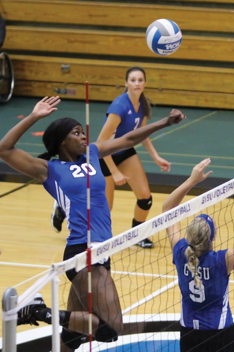 GVL / Jessica Hollenbeck Senior Eno Umoh spikes the ball down during the game on Friday afternoon.
