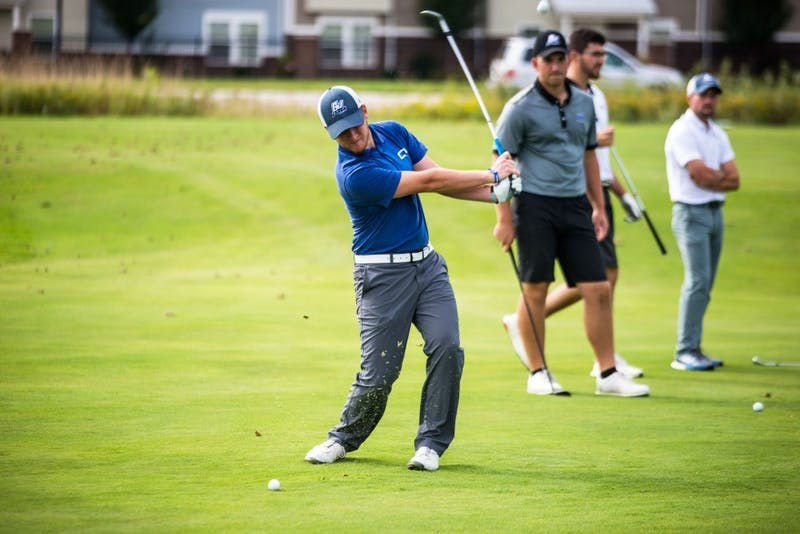 GVL / Matt ReadThe GVSU men's golf team practices pitching the ball onto the green. The team participated in some drills on Tuesday, September 19th, 2017.