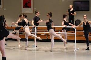 GVSU dance professor Sam Shelton (center back) instructs high school students in ballet technique during Fall Dance Day Friday, Nov. 18.