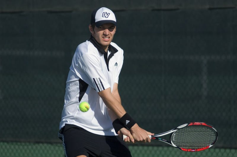 GVL Archive / Andrew MillsGrand Valley Junior Marc Roesslein hits a backhand during a match against Wayne State.