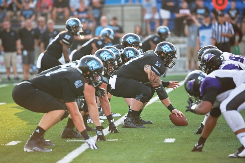 GVL / Kevin Sielaff Offensive lineman Aaron Cox (51) looks to hike the ball. Grand Valley State squares off against Southwest Baptist Thursday, September 3rd, 2015 at Lubbers Stadium.