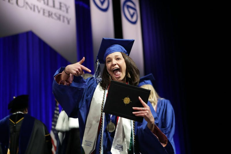 GVL / Emily FryeKatie Gipe receives her diploma during the Grand Valley State University commencement on Saturday April 29, 2017.