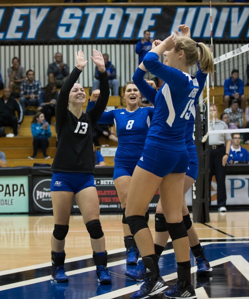 GVL/Kevin Sielaff - Amanda Glaza (13) and company celebrate a Grand Valley point. The Lakers fall to the Bulldogs of Ferris State with a final score of 1-3 Tuesday, Sept. 27, 2016 in Allendale.